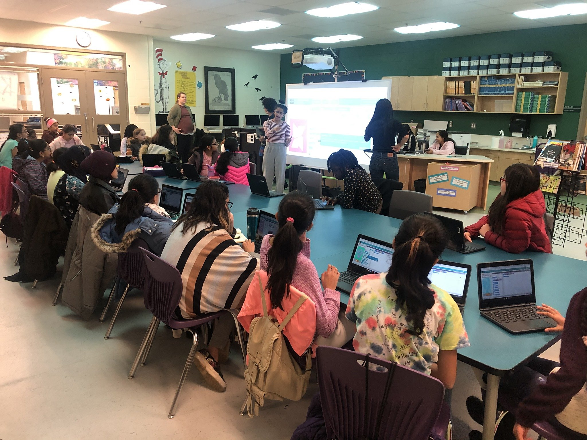 Queens In Code lead a Girls Inc. Of Northern Alberta Operation S.M.A.R.T. Session.